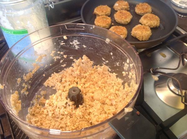 Falafel mixture and golden babies frying in coconut oil.