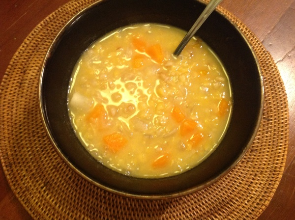 A steaming bowl of Smokey Pea and Barley Soup