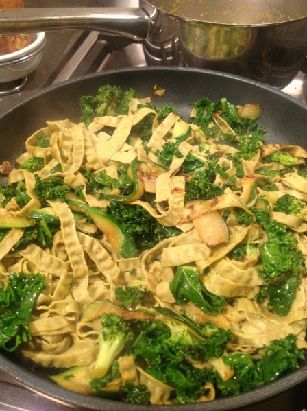 Mung Bean pasta mixed into the greens, along with nutritional yeast flakes, salt, pepper and a bit more macadamia oil
