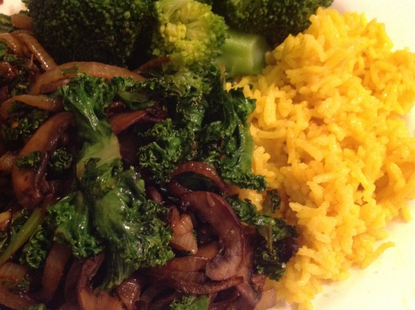 Turmeric Coconut Rice with kale stirfried with mushrooms and onion.