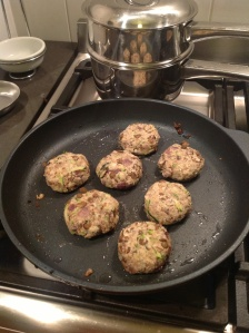The little rissoles frying in coconut oil.
