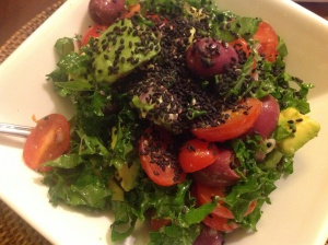 Quick Kale and Avocado Salad with kalamata olives and black sesame seeds.