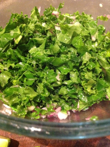 Kale and diced red onion, sousing in lemon juice and olive oil.